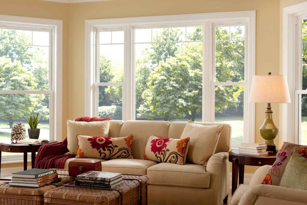 Bright, sunny living room with large windows